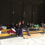Two happy Campers Montreal posing with Happiness sleeping outside